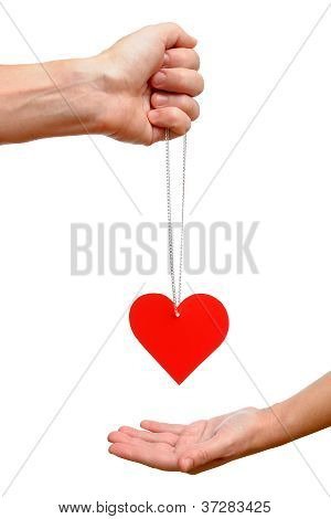 Male Hand Gives Into Female Hand Red Heart On Chain Isolated On White Background