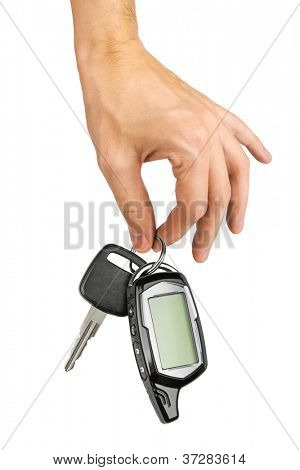 Car key in hand, isolated on white background