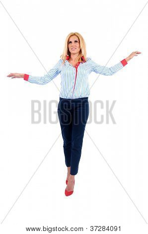 Isolated young business woman walking rope