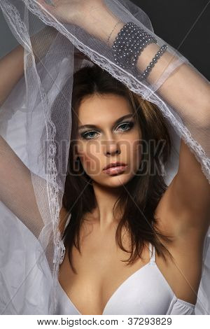 Sexy woman covered by white veil