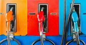 foto of dispenser  - colorful fuel oil gasoline dispenser at petrol filling station - JPG