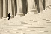 pic of supreme court  - A man ascending the steps at the entrance to the US Supreme Court in Washington DC - JPG
