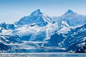 picture of snow capped mountains  - Glacier and snow capped mountains in the Glacier Bay National Park Alaska - JPG