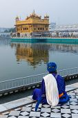 picture of gurudwara  - Unidentifiable Seekh Nihang warrior meditating at Sikh temple Harmandir Sahib - JPG