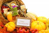 stock photo of gourds  - Happy Thanksgiving card and scarecrow among a cornucopia of autumn vegetables - JPG