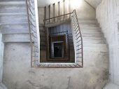stock photo of bannister  - Architectural detail of poured concrete spiral staircase - JPG