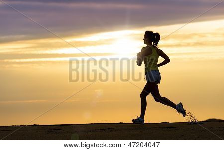 Athlete Running At Sunset On Beach