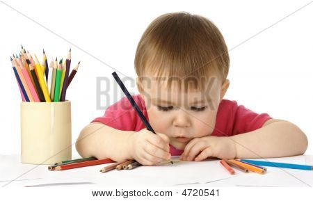 Cute Child Draw With Color Crayons