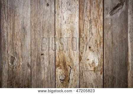 grunge weathered barn wood background with knots and nail holes