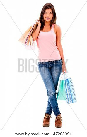 Happy female shopper holding shopping bags - isolated over white