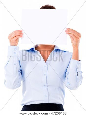 Business woman holding banner covering her face - isolated over white