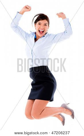 Happy business woman jumping - isolated over a white background