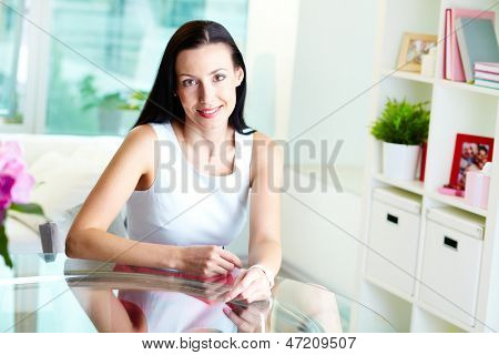 Portrait of a lovely young woman dressed with elegance, romantic entourage