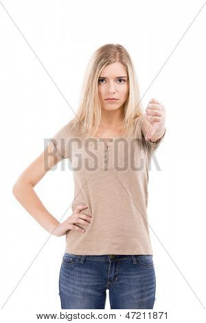 Unhappy woman looking to the camera with thumbs down, isolated over white background