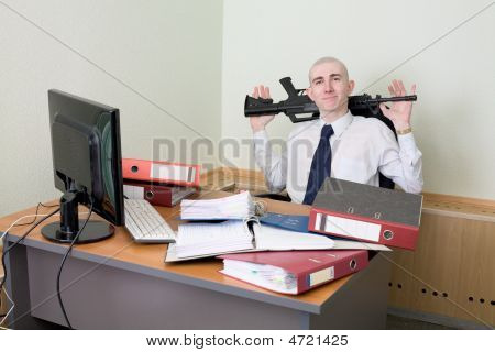 Self-satisfied Worker Of Office Armed With A Rifle