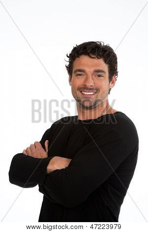 Attractive young man, with dark, wavy hair smiles to the camera. Isolated on white background with space for your text.