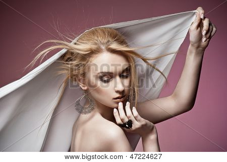 Beautiful woman with ring and earrings