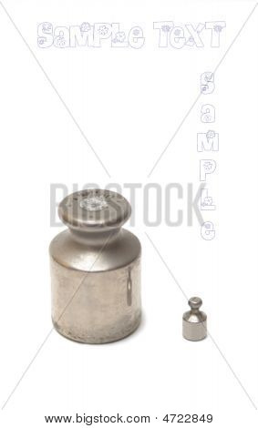 Big And Small Balance Weights An A Symbol Of Imbalance Isolated On White