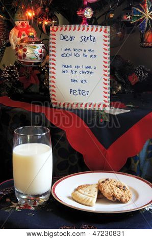Dear Santa letter with milk and cookies.