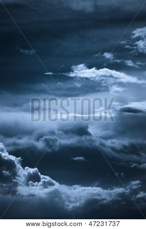 dark blue night sky with clouds formation