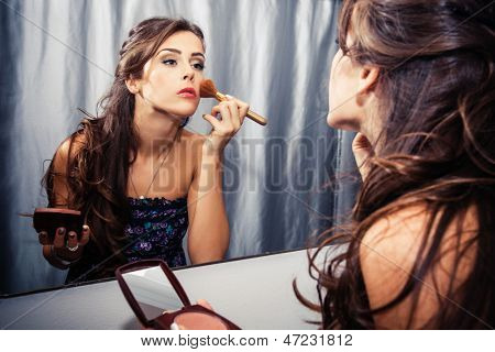 woman apply makeup indoor shot