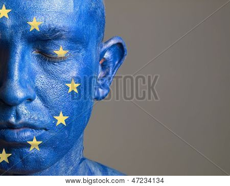 Man With His Face Painted With The Flag Of European Union (4)
