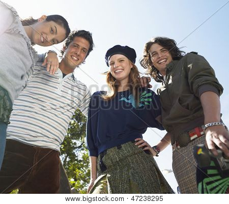 Portrait of smiling young trendy friends outdoors
