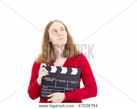 Young Woman With Clapperboard Thinking About Something