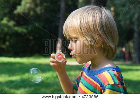 Boy With Soap Bubbles