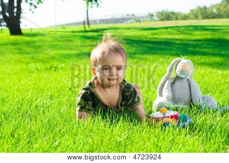 Baby On Grass