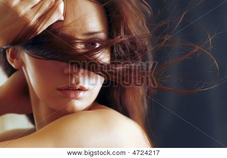 Chestnut Hair Of The Girl Develop On A Wind