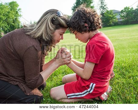 Single Mother And Son Praying