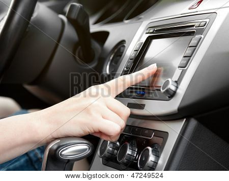 Finger On Dashboard With Gps Panel And Tv/dvd/audio System