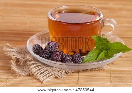 Fruit tea in cup with berry on isoleted background