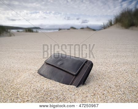 Billfold On The Beach