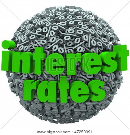The words Interest Rates on a sphere of percentage signs to illustrate comparing bank fees and percent rate for loans, mortgage or credit card expenses