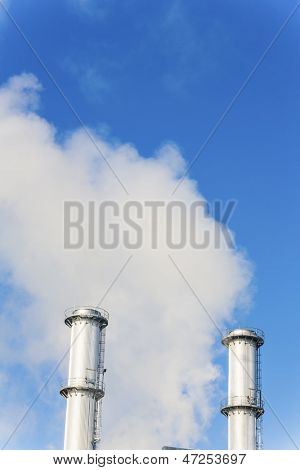 chimney of an industrial company a wake smoke. symbolic photo for environmental protection and ozone.