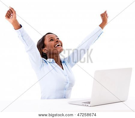 Successful business woman working online on a laptop - isolated over white