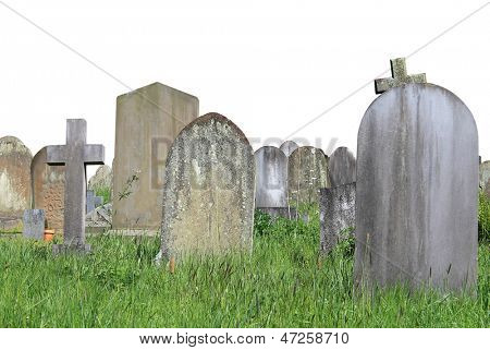 Old graves in cemetery isolated on white background with copy space.