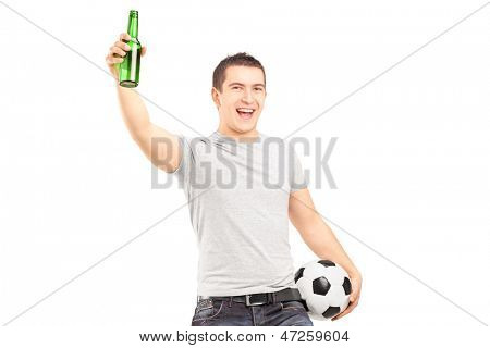 Euphoric sport fan holding a beer bottle and football cheering isolated on white background