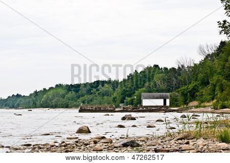 Boathouse on a rocky shoreline
