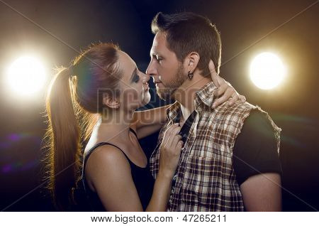 Beautiful Couple In Love Flirting. The Girl Wants To Kiss A Guy.