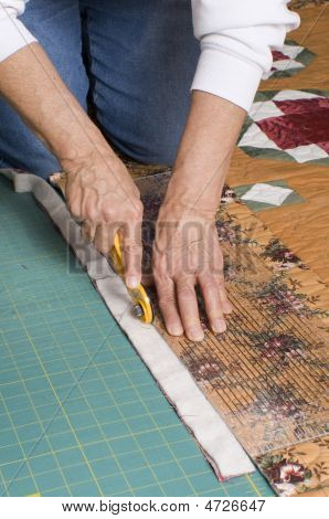 Woman Cutting Fabric