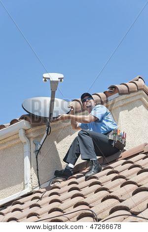 Satellite Installation Technician Wiring Dish to Home