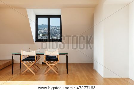 Interior, wide loft, hardwood floor, view dining table