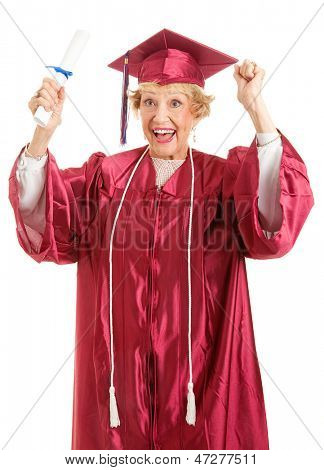 Senior lady olding her diploma, thrilled to finally be graduating.  Isolated on white.