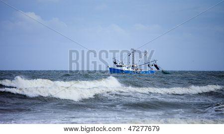 shrimp boat dragging net in rough seas