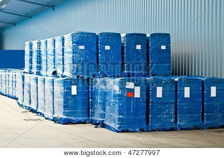 Blue plastic wrapped packets in a warehouse store