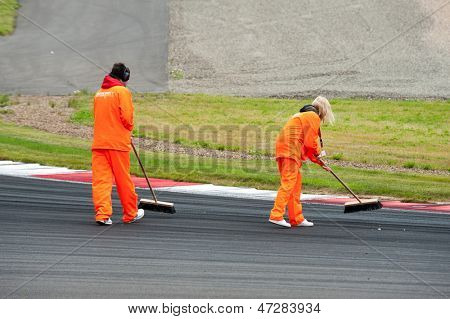 MOSCOW - JUNE 23: Staff cleans the track at World Series by Renault in Moscow Raceway on June 23, 2013 in Moscow