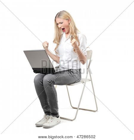 young woman screaming in amazement looking at the computer